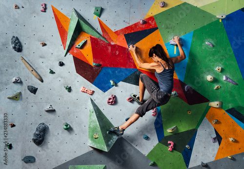 Woman on climbing wall Fotobehang