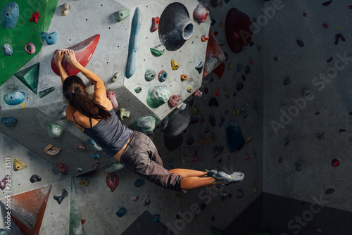 Fototapeta Woman on climbing wall obraz
