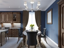 Dining Room In Classic And Luxury Style, With Dining Served Table With Decorative Elements, Four Upholstered Chairs, Two Chandeliers And Island With Decor.