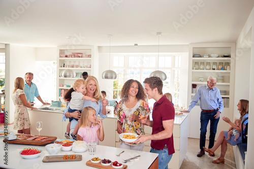 Fototapeta Multi-Generation Family And Friends Gathering In Kitchen For Celebration Party obraz
