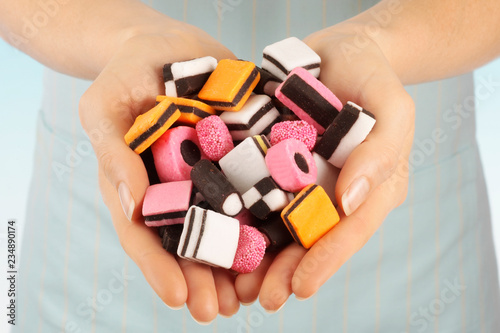 Photo WOMAN HOLDING LICORICE ALLSORTS SWEETS / CANDIES