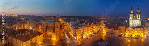 Poster Madrid Prague - The panorama with the St. Nicholas church, Staromestske square and the Old Town and church of Our Lady before Týn at dusk.