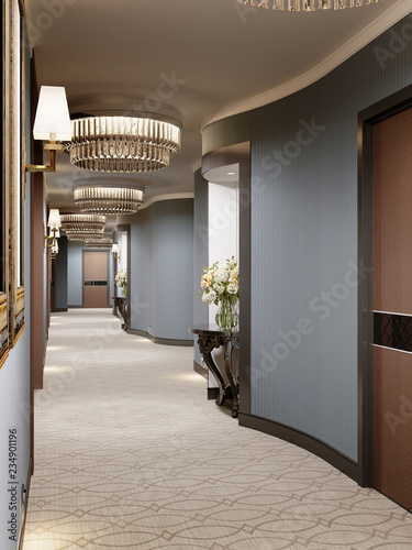 Valokuvatapetti Luxurious modern corridor with blue walls, decorative niches with consoles and glass chandeliers