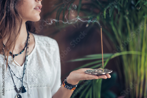 Foto op Aluminium Ontspanning Incense Stick. Caucasian Woman Enjoying Aroma Stick