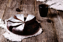 Kladdkaka. Traditional Swedish Moist Chocolate Cake On Old Rustic Wooden Table Decorated Dry Twigs, Pine Cones And Birch Bark. Fika. Hygge