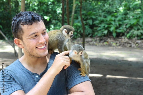 Ethnic man with monkey on his shoulder