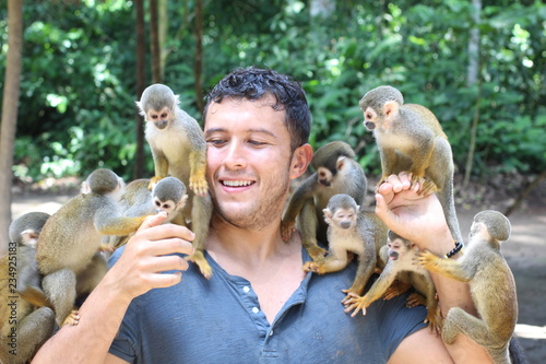 Beautiful monkeys interacting with a human Canvas Print