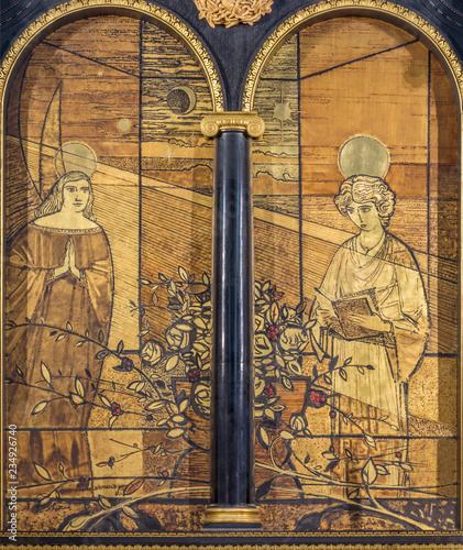 LONDON, GREAT BRITAIN - SEPTEMBER 16, 2017: The Annunciation painting on the wood on the altar in church in St Clement Danes from 20. cent.