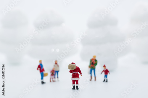 Miniature people in Christmas Theme  Santa Claus giving Christmas