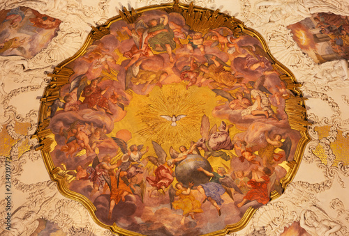PRAGUE, CZECH REPUBLIC - OCTOBER 18, 2018: The baroque fresco of Angels with the Holy Spirit in church kostel Svaté Voršily by Jan Jakub Stevens ze Steinfelsu (1707).