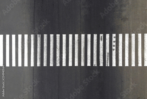 Aerial. Pedestrian crosswalk zebra with no pedestrians. Top view. Fotobehang