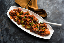 Indian Chilli Chicken Dry, Served In A Plate Over Moody Background. Selective Focus