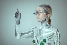Futuristic Silver Robot Gesturing With Hand And Looking Away Isolated On Grey, Future Technology Concept