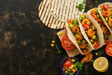 MEXICAN FOOD. Homemade Tacos With Shrimps And Vegetables On A Cutting Board. View From Above,overhead. Place For Text.