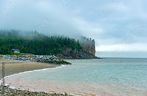 Photo Village of Alma, located on the Bay of Fundy in New Brunswick, Canada, has the h