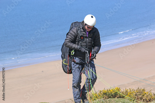 Paraglider preparing to launch