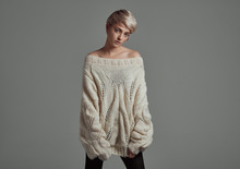 Fashion Photo Of Young Woman With Blond Short Hair Wear Wool Sweater