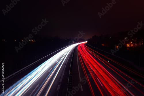 Foto op Plexiglas Nacht snelweg Light trails of cars at night on a highway