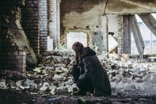 Sad Man Kneels And Looks At Ru...