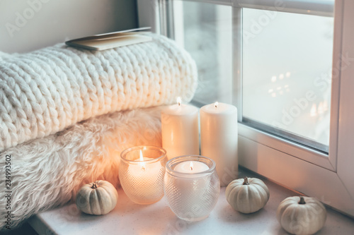 Fototapeta Hygge scene with sweater and candles