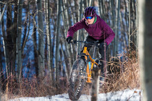 Woman Riding A Fat Bike In The...