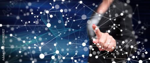 Woman touching a virtual network