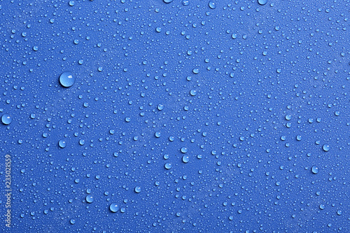 Stampa su Tela  Water drops on color background, top view