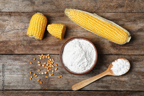 Flat lay composition with corn starch on wooden background