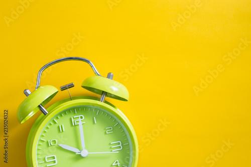 Fotografía  Alarm Clock With Yellow Background