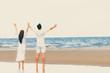 Couple going honeymoon on tropical beach in summer