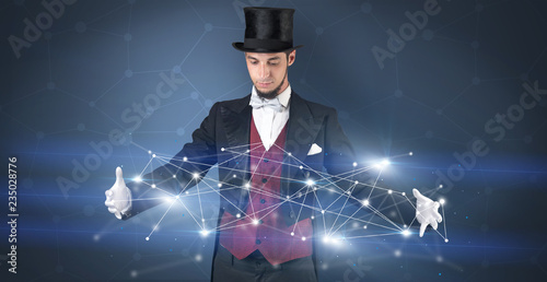 Fotografia  Magician with blue background and geometrical connection between two hands