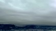 Mountains peaks covered with snow and clouds above timelapse