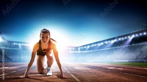 Obraz na plátně Female athlete ready to run. Mixed media