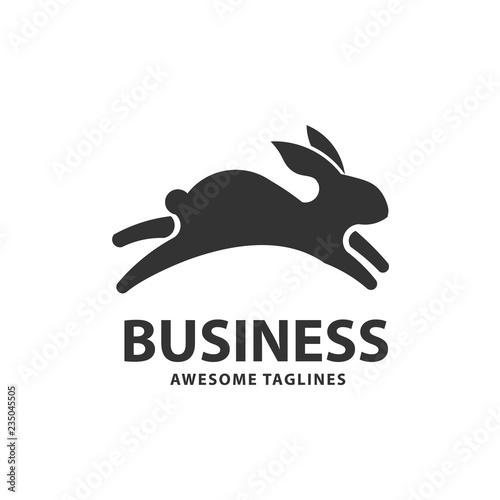 Naklejka premium kreatywny skaczący królik lub króliczek logo wektor element koncepcji