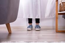 Girl's Feet Behind The Curtain
