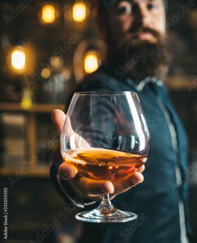 Drink barman. Pub retro vintage interior. Hipster barman concept. Swag guy with alcohol. Drunk man. Whiskey, brandy, cognac concept.