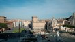 High angle panning left view of city skyline and cityscape above Piazza Venezia seen from Il Vittoriano on sunny day in Rome, Italy. 4K UHD at 29.97fps