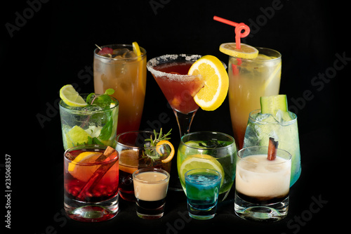 Fotografie, Obraz  Mix alcoholic cocktails together with isolated black background
