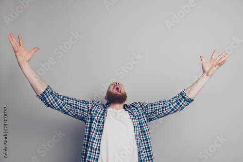 Photographie  Photo of positive optimist person man in casual wear stand isola