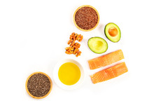 Healthy Omega-3 Diet Food Ingredients. Raw Salmon, Avocado, Nuts, Chia Seeds, Flaxseeds, Shot From Above On A White Background With Copy Space