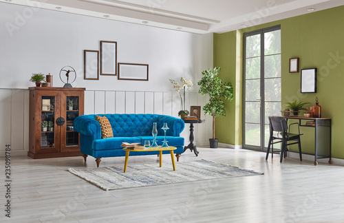 Modern living room, white wall and green wall decoration with blue ...