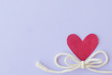Bow Rope  And Red Heart On Purple  Background