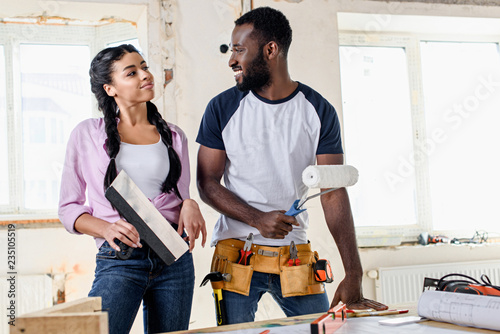 Fotografie, Obraz  attractive young couple making renovation of apartments