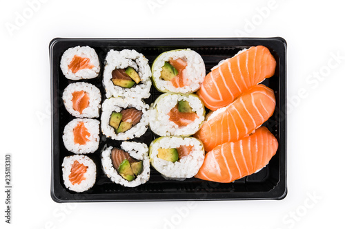 sushi assortment on black tray isolated on white background. Top view