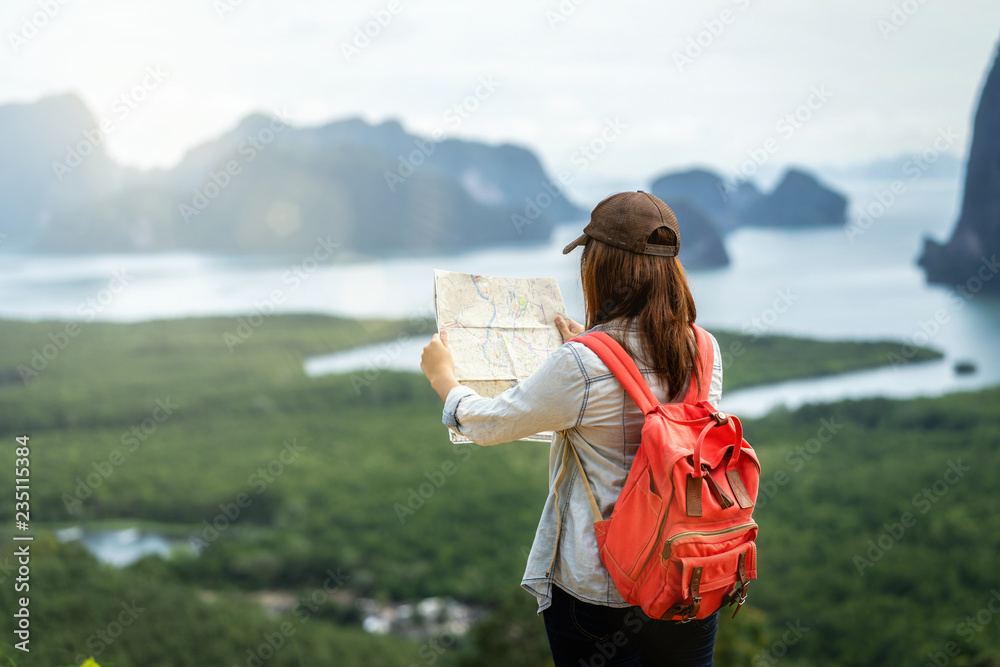 Fototapety, obrazy: Back side of Asian woman traveler looking the map for travel with backpacker at Fantastic Landscape of samed nang chee view point, travel and holiday concept
