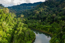 Aerial Drone View Of Mountainous Tropical Rainforest And A Small Lake In Thailand
