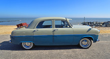 Classic Blue Motor Car Parked On Seafront Promenade.