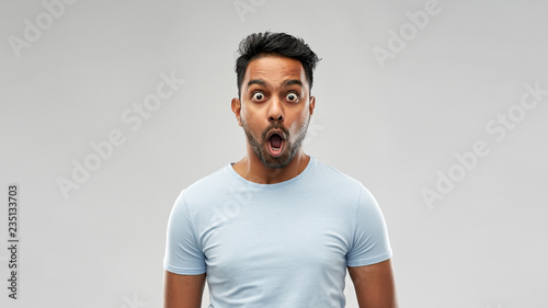 emotion, expression and people concept - shocked or scared man in t-shirt over g Wallpaper Mural
