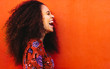 canvas print picture - Laughing african young woman with curly hair