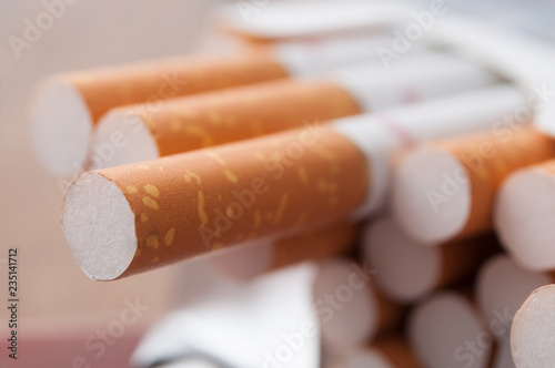 closeup of cigarettes in cigarettes pack  on wooden table background Fototapet